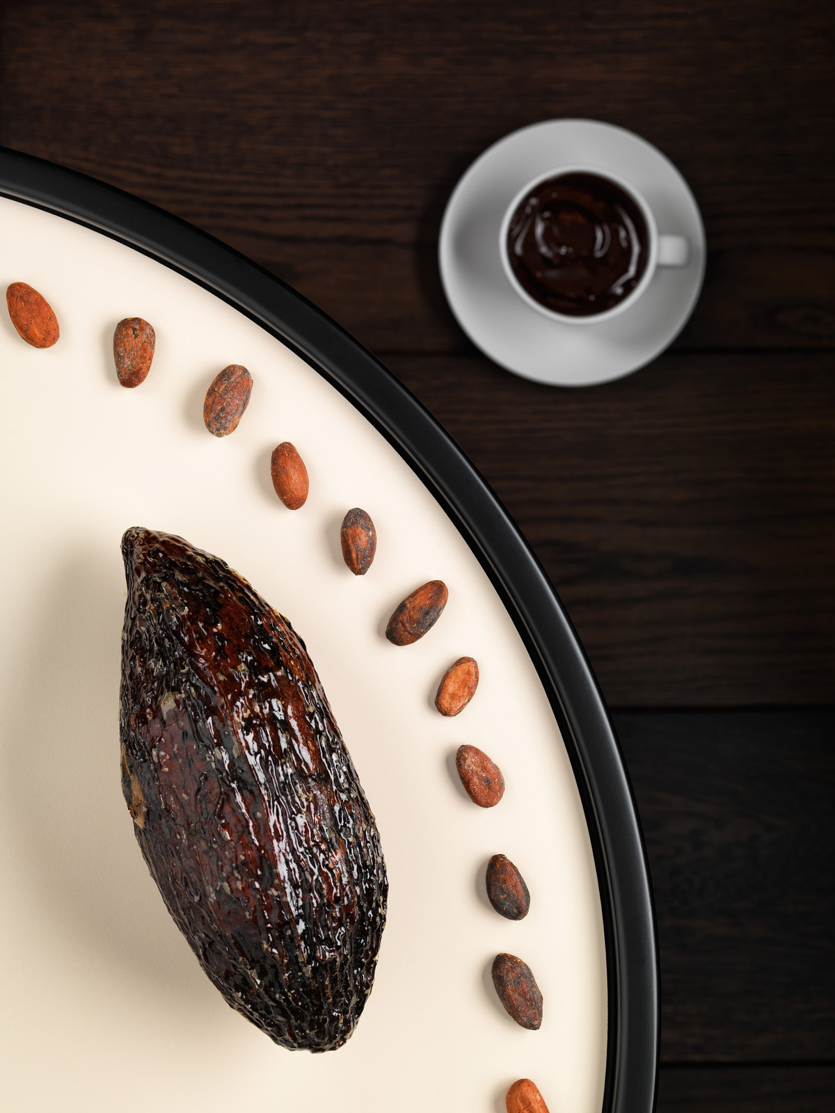Cocoa pod, beans and hot chocolate
